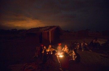 Lalaua district, Nampula Province, Mozambique, August 2015: Members Laurinda Diago's family around the fire at night.     Photo by Mike Goldwater